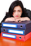 Young bussiness woman with stack of papers Royalty Free Stock Photography