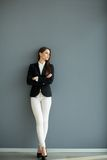Young bussiness woman by the wall Royalty Free Stock Photo