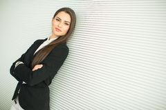 Young bussiness woman by the wall Stock Photos