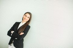 Young bussiness woman by the wall Stock Photo