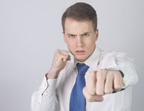 Businessman fight for his Job Stock Image