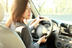 Young bussinesswoman driving a car Royalty Free Stock Photography