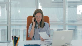 Young busy attractive business woman working in modern office. Timelapse. stock footage