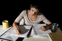 Young busy beautiful Spanish girl studying at home late night looking preparing exam concentrated. And quiet in education stress concept Stock Photo