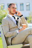 Young busy businessman on the phone Royalty Free Stock Photography