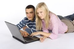 Young busy couple with laptop Stock Photos