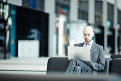 Businessman in lounge Stock Photos