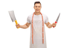 Young butcher with a cleaver and a knife Stock Images