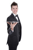 Young butler or waiter in black suit isolated on white Royalty Free Stock Photos