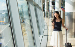 Young buzy woman with phone while waiting for Stock Photo
