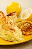 Young cabbage with a lemon sauce. Stock Images