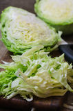 Young cabbage on a wooden cutting board Royalty Free Stock Photos
