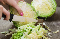 Young cabbage on a wooden cutting board Royalty Free Stock Images