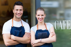 Young cafe owners in doorway Royalty Free Stock Images