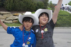 Young Calgary Stampede Fans. This year is the 100th Anniversary of the Calgary Stampede. These two just had a blast at a community event to promote the event Stock Image