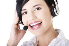 Young call-center assistant smiling at the camera Royalty Free Stock Photos
