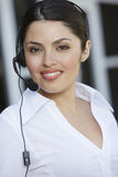 Young Call Center Employee Smiling Royalty Free Stock Photos
