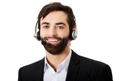 Young call center man. Young handsome smiling call center man Royalty Free Stock Photos