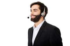 Young call center man. Young handsome smiling call center man Royalty Free Stock Photo
