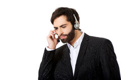 Young call center man talking to customer. Young handsome call center man talking to customer Royalty Free Stock Image