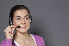 Young call center operator answering the phone Royalty Free Stock Photos