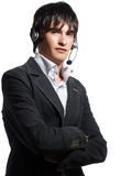 Young call center operator man. A portrait about a trendy customer service operator young man who is smiling and he has a headphone. He is wearing a white shirt Royalty Free Stock Image
