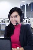 Young call center operator smiling at camera Stock Images