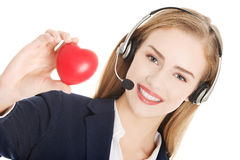 Young call center woman holding heart Royalty Free Stock Images
