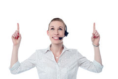 Young call center woman pointing up Royalty Free Stock Photography