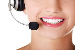 Young call-centre assistant smiling at the camera Stock Photo