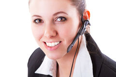 Young call centre employee with a headset Royalty Free Stock Photos