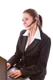 Young call centre employee with a headset Royalty Free Stock Photo