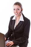 Young call centre employee with a headset Stock Photos