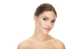 Young calm adorable brunette woman with cute makeup posing with bare shoulders against white studio background Stock Photography