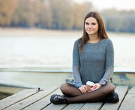 Young calm beautful brunette woman with her smartphone outdoors Stock Photography