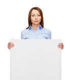 Young calm businesswoman with white blank board Royalty Free Stock Image