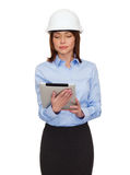 Young calm businesswoman in white helmet Stock Photos