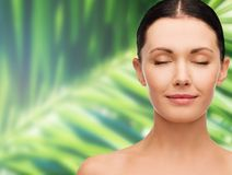 Young calm woman with closed eyes Royalty Free Stock Photo