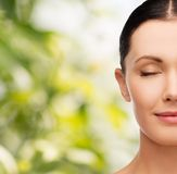 Young calm woman with closed eyes Stock Images