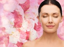 Young calm woman with closed eyes Stock Photos