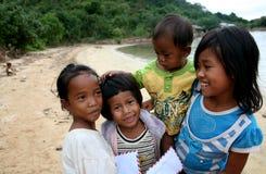 Young Cambodiam Postmen. Small fisherman's island in Cambodia royalty free stock photo