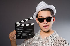 Young camera assistant with the clapperboard Royalty Free Stock Photography