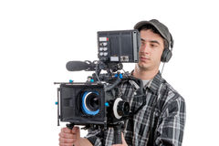 Young cameraman with movie camera Royalty Free Stock Image