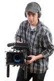 Young cameraman with movie camera Stock Images