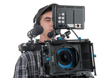 Young cameraman and professional camera Royalty Free Stock Photography