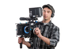 Young cameraman and professional camera Royalty Free Stock Photo