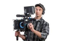 Young cameraman and professional camera Royalty Free Stock Photo