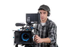 Young cameraman with professional camera Royalty Free Stock Image