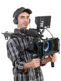 Young cameraman with professional camera Royalty Free Stock Photos