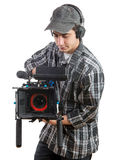 Young cameraman with professional camera Royalty Free Stock Photo